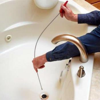 Механическая очистка канализации пружиной